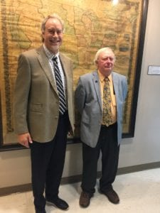 SUNY Broome President Kevin E. Drumm and Professor Doug Garnar in front of the 1857 map.