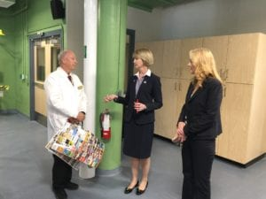 Chemistry Professor Harold Trimm, SUNY Chancellor Kristina Johnson and Dean of STEM Michele Snyder in the Calice Center's food science labs on Oct. 17, 2018.