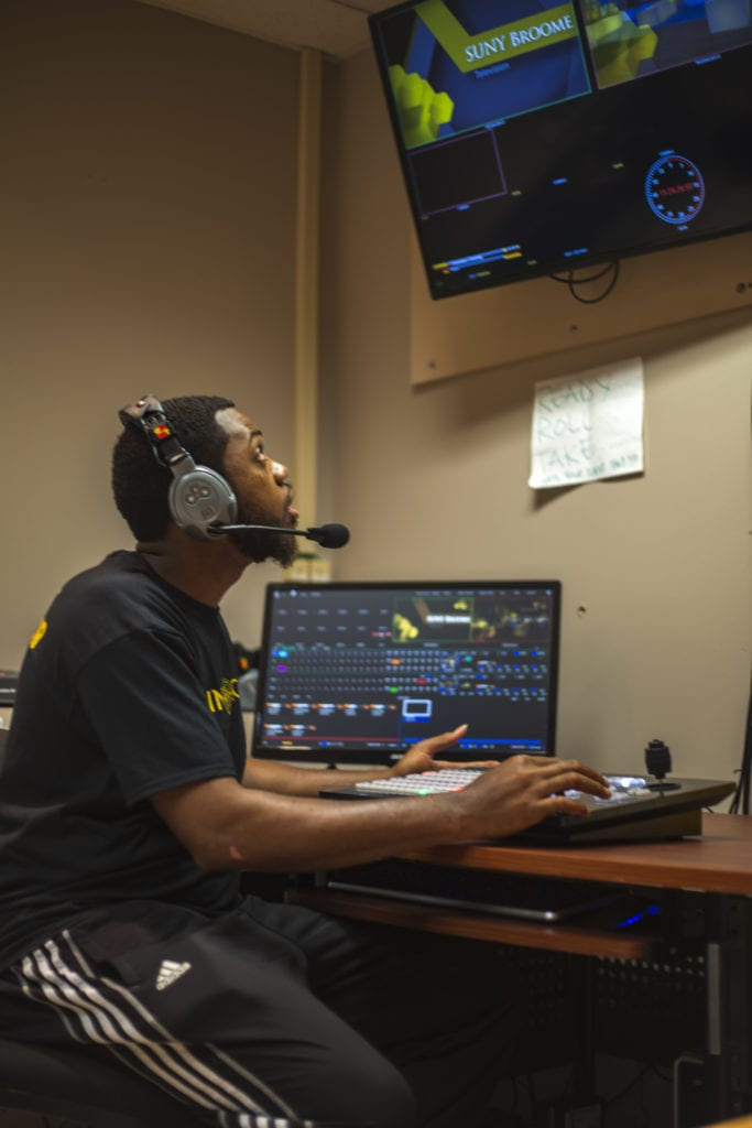 Graduate William Mason is now a board operator for a Syracuse radio station